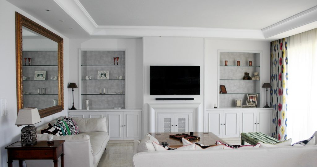 Hang your TV above the fireplace to avoid creating a second focal point